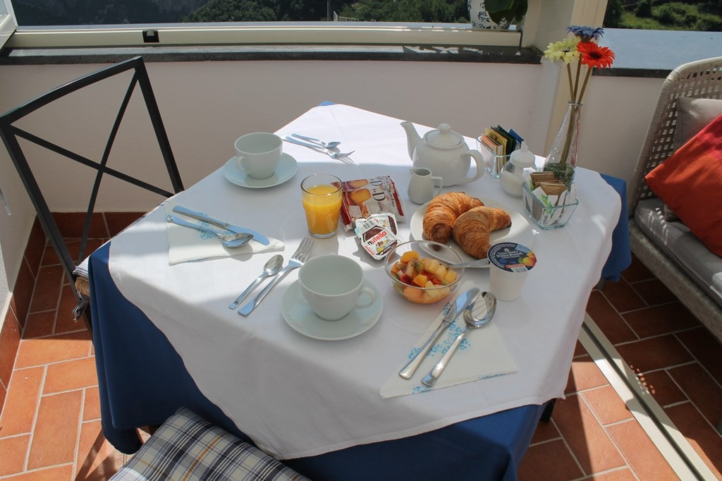 Enjoy our breakfast on the terrace overlooking the Amalfi Coast